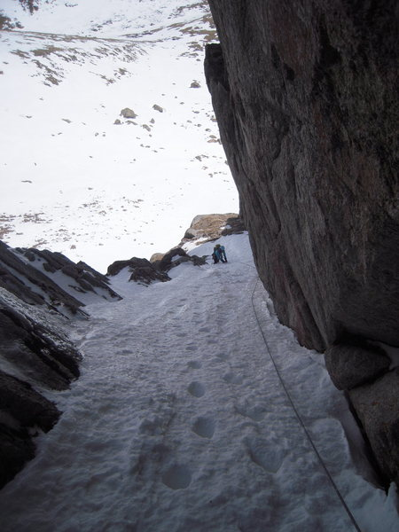 Exiting mixed terrain to access snow beneath the right-facing fin.