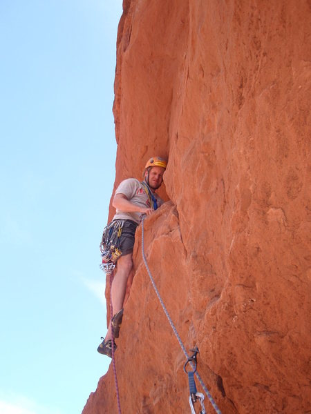 "Me leading the 3rd pitch just off the 2nd belay. There is a good ledge with two decent pockets to clip the bolt from before pulling the bulge on the ""hollow brown sugar hold""."
