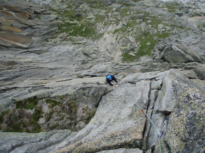 Finishing off the crux sixth pitch.