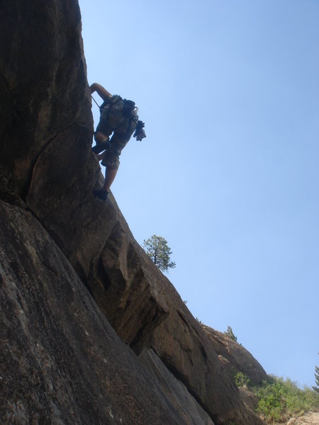 Rock Climbing Photo: Myong finds her way over the roof.