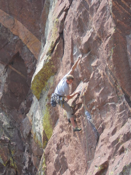 Chris making the first crux move.<br> <br> Photo by Karl Manteuffel.