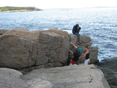 "Chris Rose, Jasmine Carroll, Zach Bailey seaside bouldering. Chris Rose First Ascent on ""ZigZag to the Stars""."