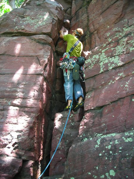 "Mike Sohasky starting up the first pitch of adventure climb ""Jungle Gym"" on toasty June day.  Major Mass, Devil's Lake."
