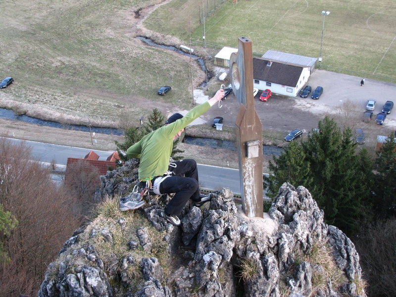 Sebastian clipping the piton at the top of Zehnerstein.