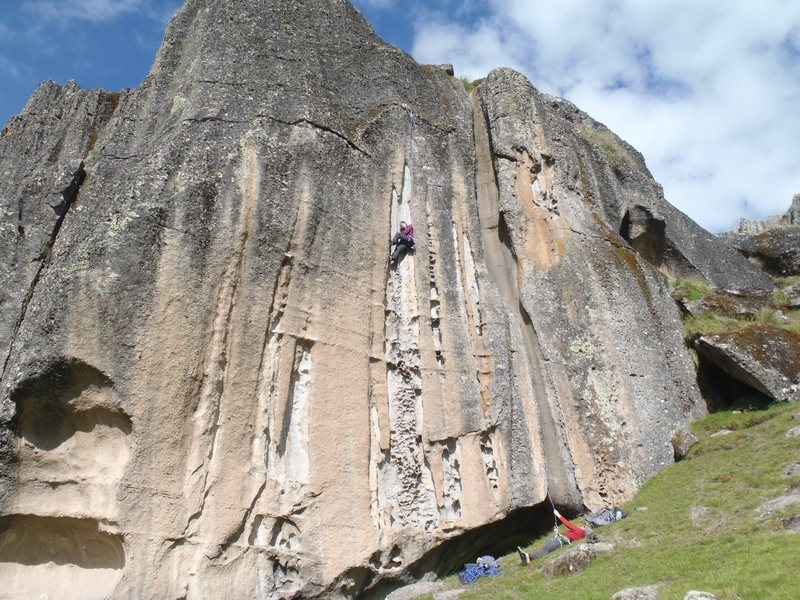 """Jewls kicking it on """"Fancy a Good Route"""" 10d, some harder routes to the left of her."""