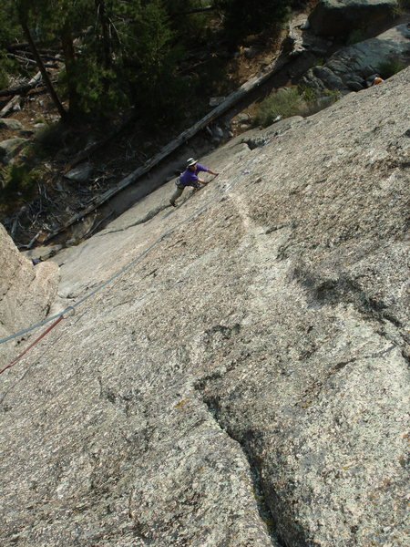 Tom on the traverse after the crack peters out.  (Looking down the Pizza Face. BTW, there's only 2 bolts left, counting the 1st one on EC.)