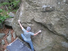Pete on Penny Pincher (V6) on the Cube Boulder just before the rain hit.