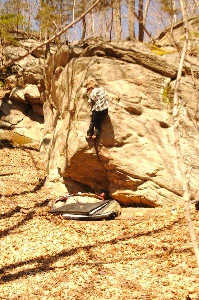 Felix climbing that rock
