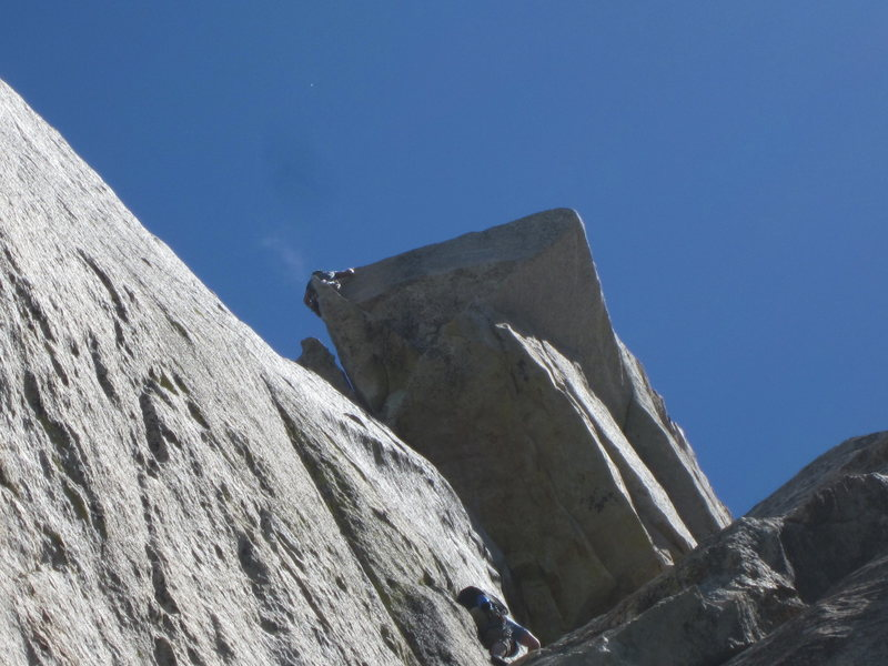 "Rob takin on the second pitch of Open Book in the foreground and an unknown climber on the ""Traitor Horn"""