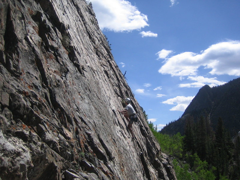 Rock Climbing Photo: Doug on Zebra in morning sun with Mt. Royal in the...