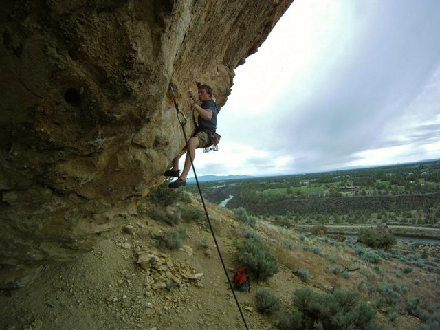 the beginning of the crux, bring your foot to left hand and heel hook, get solid and stand as high as possible, powerful crossover with your left hand, grab the sidepull, reset hands and dyno to huge jug.<br> <br> Photo by Brain Mosbaugh<br>