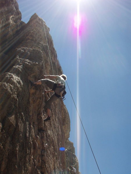Susan basking in the sun while climbing 'Jack off'