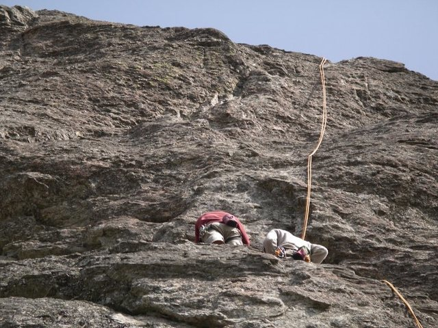 Rocks of Sharon. Big Rock - Council of Elders 1 or 2 pitch 5.9 to 10a-b. Climb is just to the left of the rope directly above the person in the red jacket(ME).