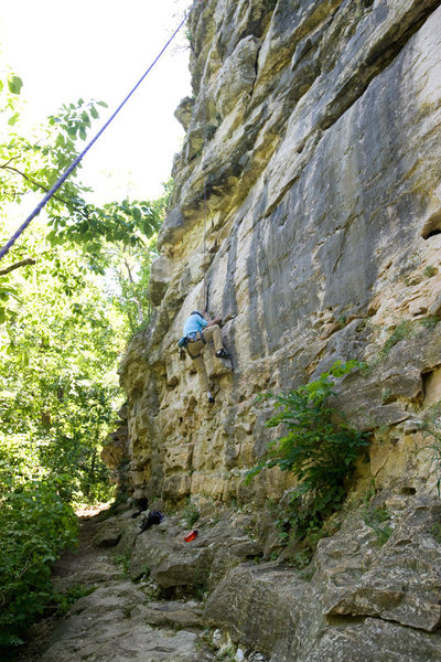 Michael McKay climbs through the opening layback section of Three Horns, at Capen Park.<br>