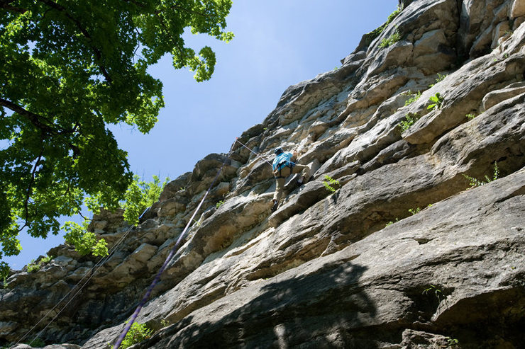Michael McKay climbs through the crux of Mister Easy at Capen Park.  In this photo, Michael takes the harder right-hand variation.