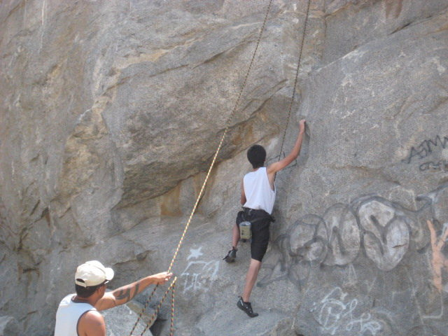 My sister's boyfriend going up Mantle Marathon, his first 5.10a outdoors.