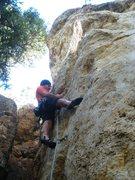 Rock Climbing Photo: Beginning the awkward lieback at mid-height.