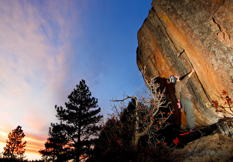 Rambo sizing up the crack with an amazing sunset happening behind us. Perfect solitude on this Friday session on April 15th, 2011. <br> <br> Had to put down the camera to spot. We didn't send this day due to sketchiness. <br> <br> http://andylibrande.com/news/2011/05/castlewood-canyon-spring-climbing/