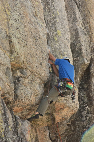 Pulling over the crux roof.