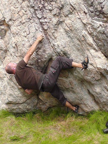 Crux, after throwing up the heel make a right hand bump to a good side pull.