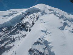 Climbers near the bergschrund / top of the ridge.