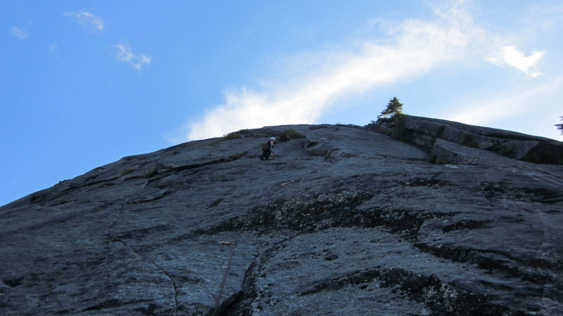 Contemplating the crux moves of getting up onto the sustained Flange, pitch 4.