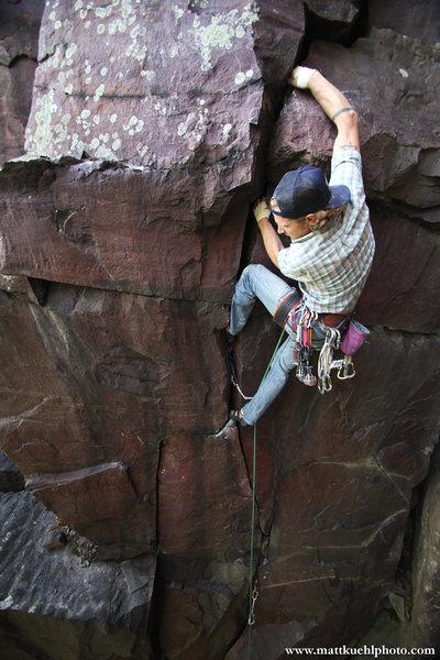Andy Hansen moves through the lower handcrack. Summer 2011. <br> <br> Photo Matt Kuehl