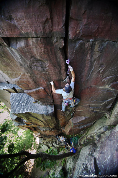 Placing the old school #4 Camalot in the lower handcrack. Summer 2011<br> <br> Photo Matt Kuehl