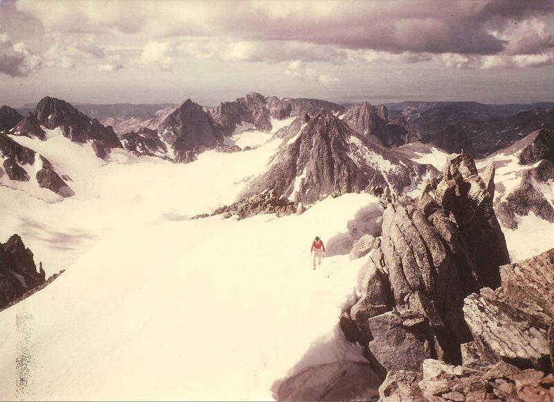 JB, summit ridge, Gannett Peak, Wind Rivers.  Mammoth Glacier in background. Aug 1984.