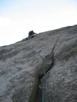 Devan Johnson on a cold day, left side of the Bucksnort Slab.