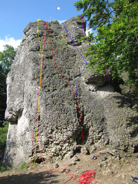 The purple line is a little different than the others in this photo because it is attempting to show a line which you can't see. Thus, Böser Wolf begins around the corner on a different wall and climbs up to the arete which you can see.
