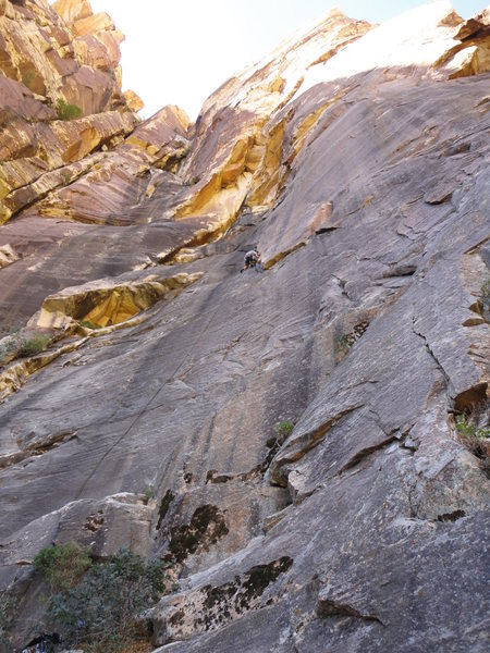 The route climbs the lower slab to the corner above.