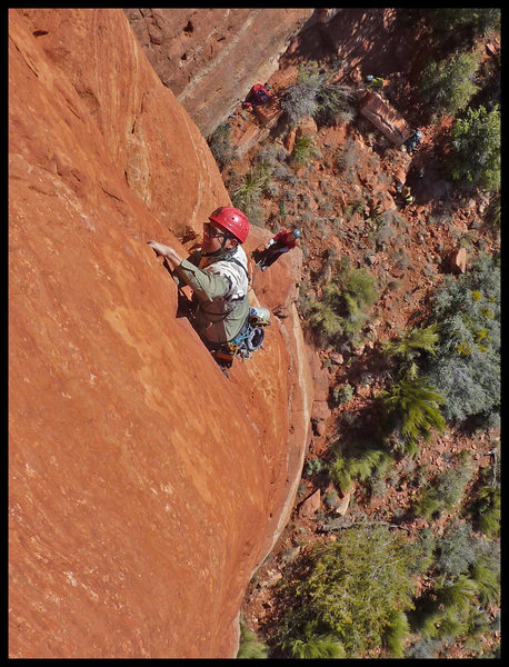 Manny leading the second (crux) pitch of Black Arrow in Sedona, with Catherine belaying.