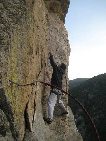 Andy Nguyen sews up Moby Dike. Photo by Chris Perkins.