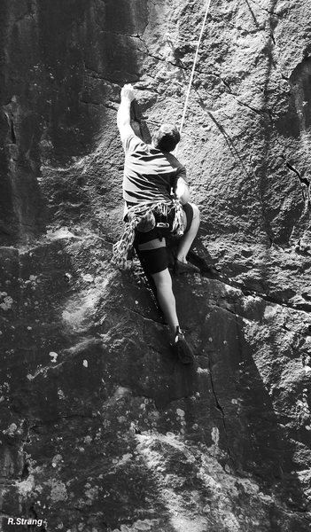 Andy Albosta follows the 3rd ascent.<br> Black Magic Spell (5.11).
