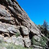 Start in the chimney on the right (above the boulder), then curve around leftward on the face.