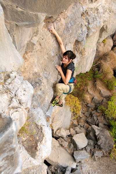 Claudia climbing above the overhanging start to a good rest on the ledge above. July 2011.