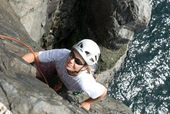 Rock Climbing Photo: Sara Reeder topping out above the waves on one of ...