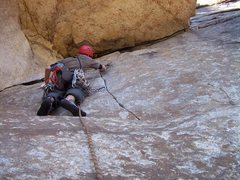 Rock Climbing Photo: Josh placing gear in the crack under the roof.