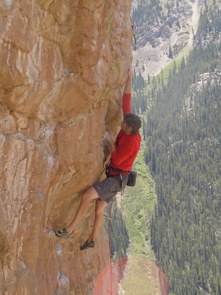 Going through the crux bulge on Glory Hole.