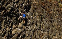 Rock Climbing Photo: Stephen E. high stepping midroute.