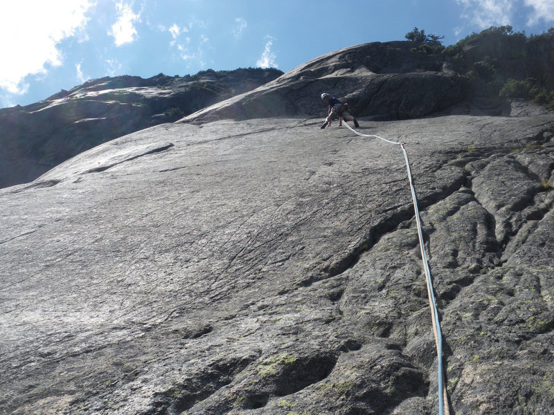 Pitch 3: Some run out on slab. Crux is the crack right/above climber