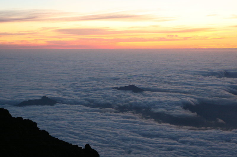 Dawn breaks over Japan, as viewed from the summit of Mt. Fuji.  Viewing one icon from another.  Tokyo is beneath the clouds.