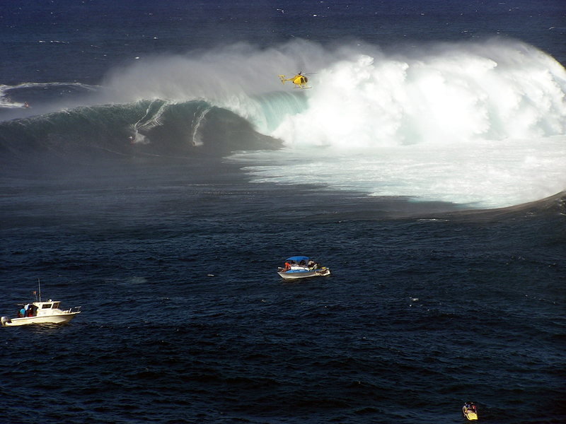 Two tow in guys share a wave at Pe'hai<br> Photo: Olaf Mitchell