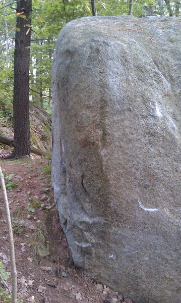 Spunky climbs this rounded arete straight up.  Holds for a sit start are present.
