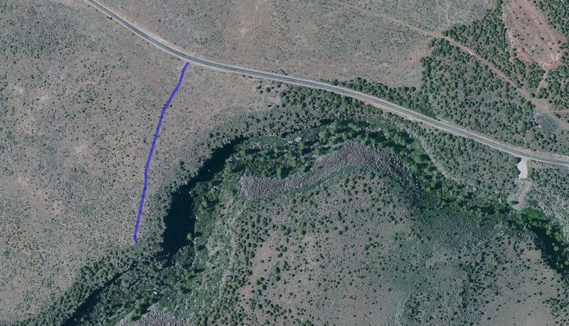 satellite photo showing the path of the trail from the road to the cliff line.  The largest shaded area on the bottom on the right side of the trail is the unemployment wall.