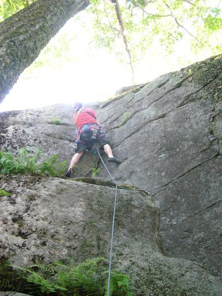 Joshua leads the upper section of Corner Crack.