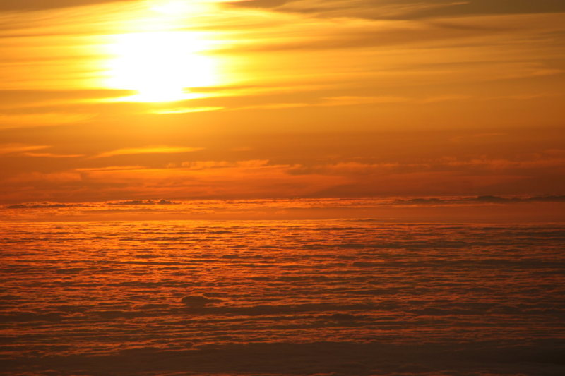 Sunrise from the summit of Fuji san.  The golden unkai below.