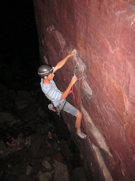 Small gear behind a hollow flake, and me glad for all of the top-rope practice that preceded this lead.  Also, the camera flash makes it look much brighter than it actually was.  Photo: Jason McKeefry.