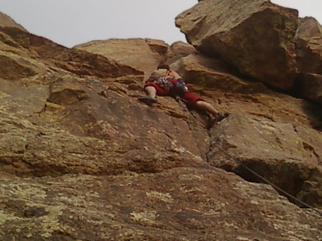 Trad climbing the route south of overhang with the TR bolts...believe it's a 5.7?